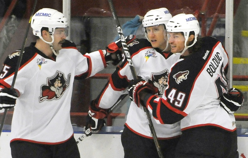 Chris Summers, left, and Alexandre Bolduc congratulate Rob Klinkhammer, center, on a goal in a Pirates game. Bolduc is one of four Pirates who will fly to Arizona Friday morning to join the NHL parent Phoenix Coyotes