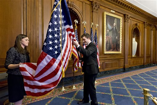 Anne Easby-Smith, left, and Trace Robbins, right, who work for House Speaker John Boehner, help to prepare the Rayburn Room on Capitol Hill in Washington,Wednesday, Jan. 2, 2013, where members of the House of Representatives will pose for pictures at an oath of office ceremony with Boehner. (AP Photo/J. Scott Applewhite)