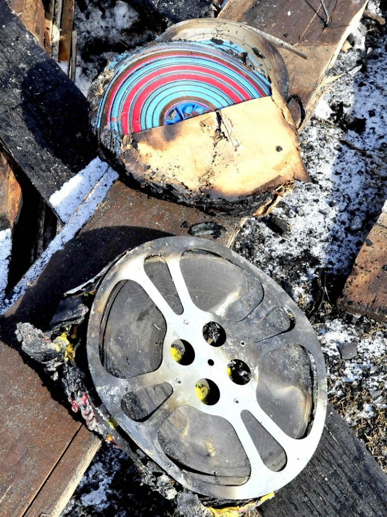 Some of the burned reels of film that were part of a lifetime collection owned by Richard Searls and were destroyed in a fire at his home in Solon last Saturday.