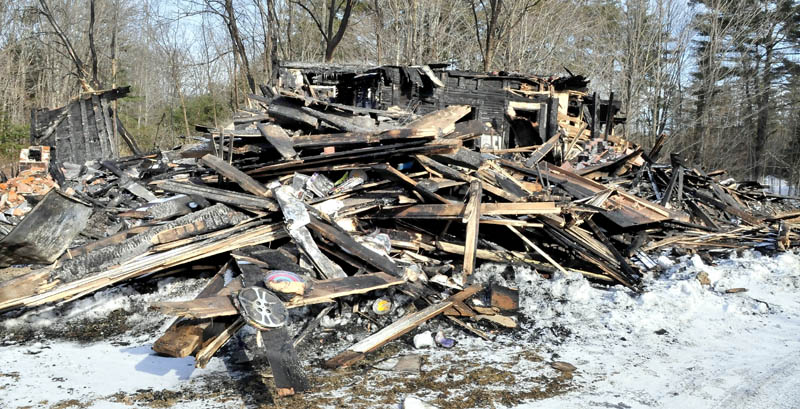 Remains of part of a huge barn that burned last Saturday at the home of Maine filmmaker Richard Searls on the River Road in Solon. Lost in the fire were tractors, farm equipment, tools and a lifetime of master film reels and original videotape.