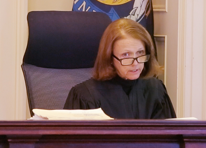 Justice Nancy Mills responds Wednesday to the Press Herald's objection to her decision closing the prostitution case jury selection process to the public and media.