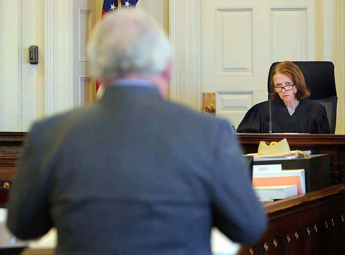 Justice Nancy Mills listens to Daniel Lilley, attorney for Mark Strong, during a motion hearing at York County Superior Court in Alfred on Thursday.