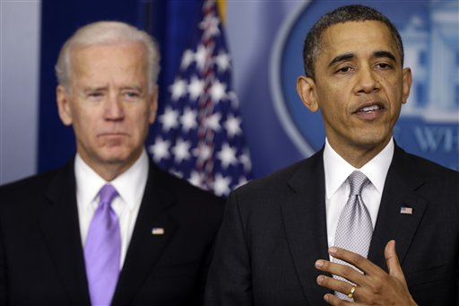 President Barack Obama stands with Vice President Joe Biden as he makes a statement Wednesday, Dec. 19, 2012. Acknowledging opposition in Congress, President Obama says he will present a plan within days, which may include stronger background checks and limits on high-capacity ammunition magazines. (AP Photo/Charles Dharapak)