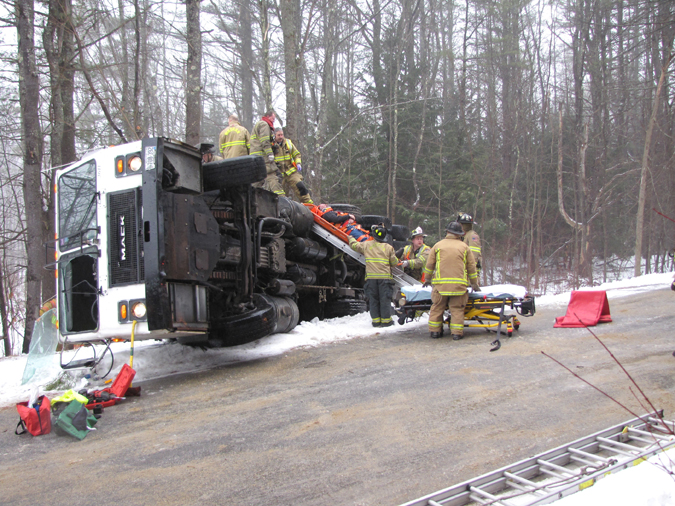 Emergency personnel work to remove a man from the scene of a truck rollover in Windham this morning. The man's identity and his condition were not available. Contributed photo by Elizabeth Nangle.