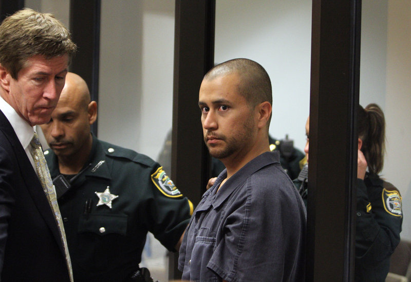 George Zimmerman, right, and his attorney Mark O'Mara. Zimmerman is accused of murdering 17-year-old Trayvon Martin. He's claiming self-defense.