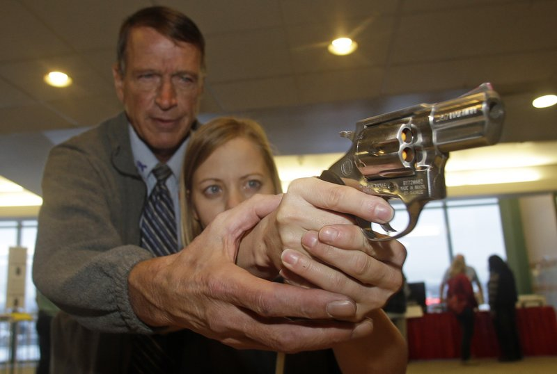 Cori Sorensen, a fourth-grade teacher from Highland Elementary School in Highland, Utah, receives firearms training with a .357 magnum from instructor Jim McCarthy during concealed weapons training for 200 Utah teachers last month.