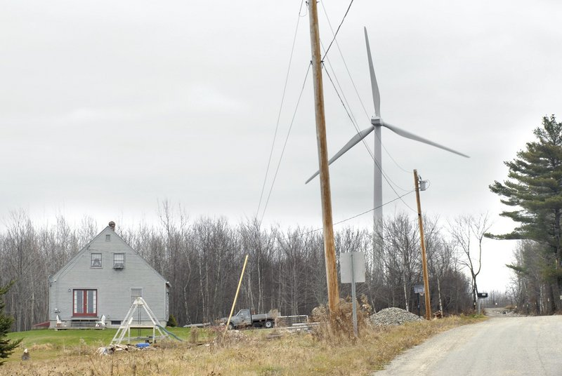 """Wind turbines like this one in Freedom help in """"preserving Maine's beauty while filling its energy needs,"""" a reader says."""