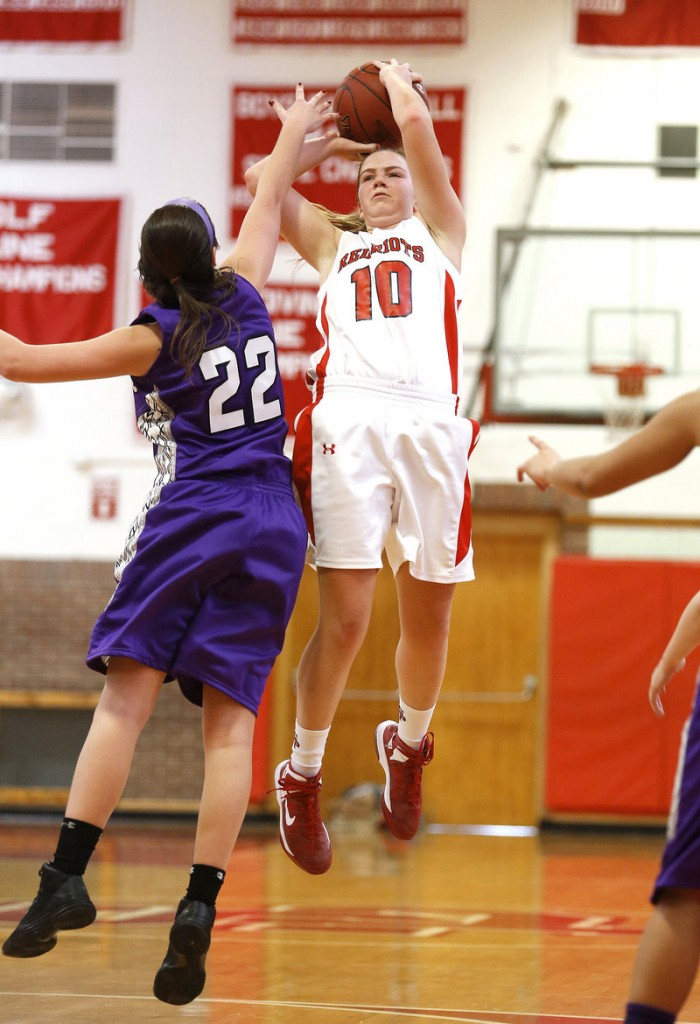 Danica Gleason of South Portland pulls up for a jump shot over Chelsea Saucier of Deering during Deering's 45-37 victory Monday at Beal Gym. Saucier's strong defense helped limit the high-scoring Gleason to nine points, with one late basket.