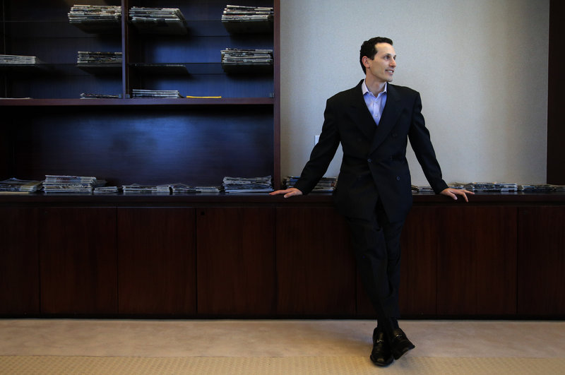 """Aaron Kushner, shown in his office at The Orange County Register in Santa Ana, Calif., says """"We're a little crazy in that we really do believe that we can grow this particular newspaper."""""""