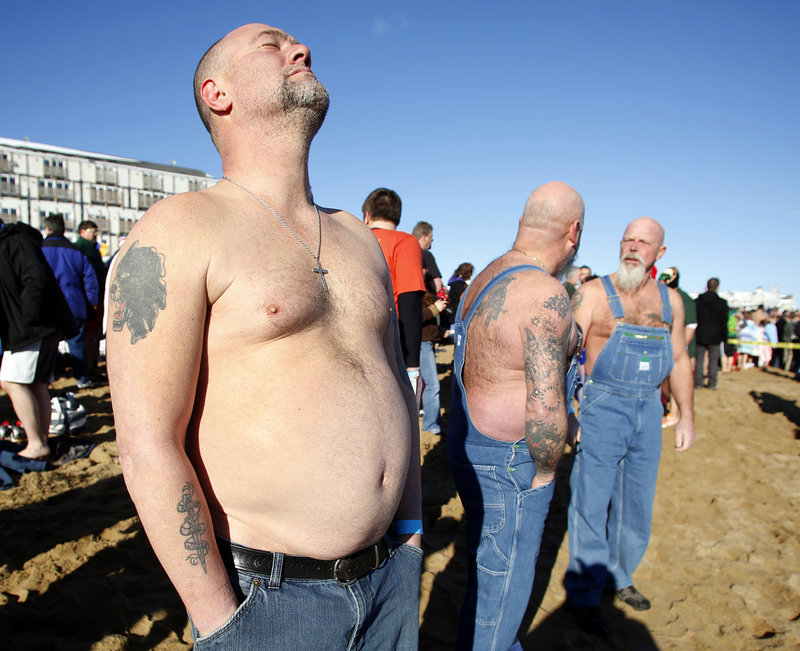 """Dean Devoe of Sanford, a member of the """"Hillbilly Rockers,"""" gets mentally prepared to jump into the Atlantic Ocean during the 25th annual Lobster Dip to benefit Special Olympics Maine in front of The Brunswick in Old Orchard Beach on Tuesday."""