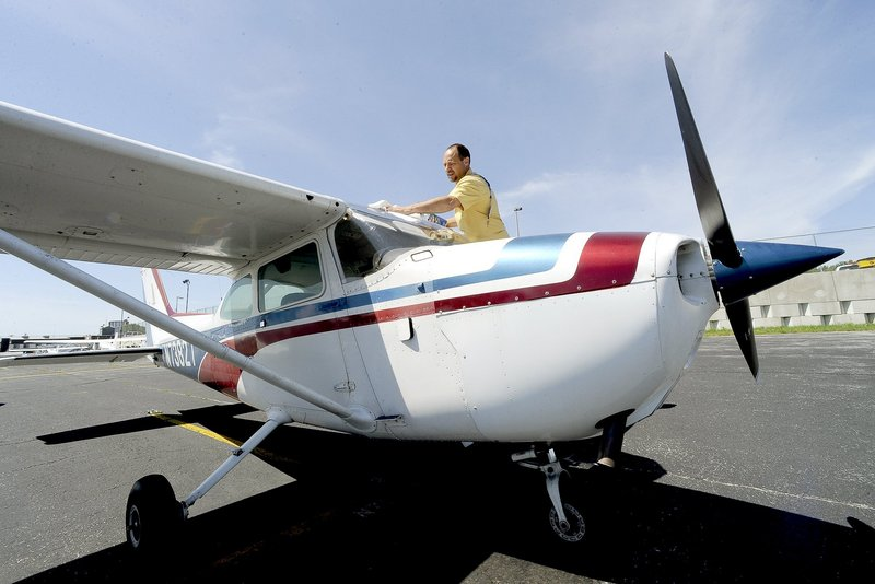 A local pilot prepares for a flight in a Cessna 172 last summer in Portland. The LePage administration is seeking a permanent sales tax exemption on airplanes and parts.