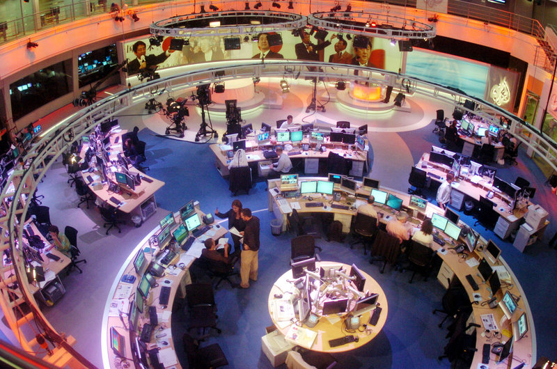 Al Jazeera's English-language staff prepares to broadcast from its Doha newsroom in Qatar in November 2006. The network announced this week that it had purchased cable-news channel Current TV and plans to transform it into a news channel called Al Jazeera America later this year. Though it remains uncertain, access to the broadcasts may be severely limited in Maine.