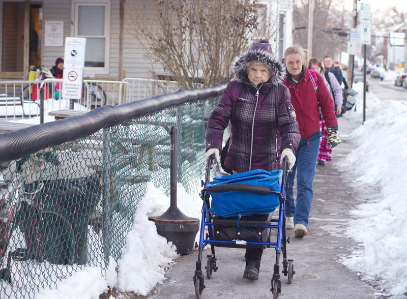 Viola Silver, 89, and her daughter, Saralyn Silver, 56, walk down Oxford Street Thursday after a night at the Oxford Street Shelter.