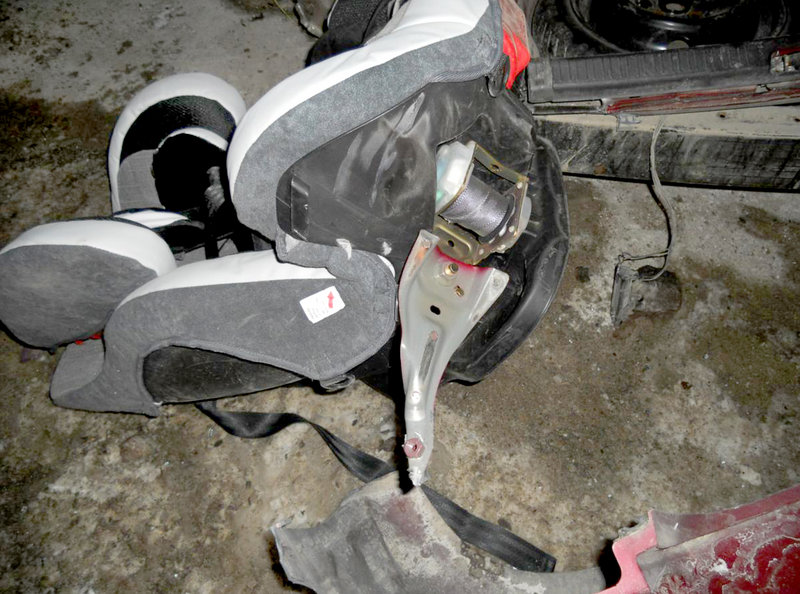 The infant car seat in use at the time of a collision in Raymond on Thursday shows how it was still attached to the car's seat belt mechanism after the impact and after a 6-month-old child was thrown from the car and from the seat itself.