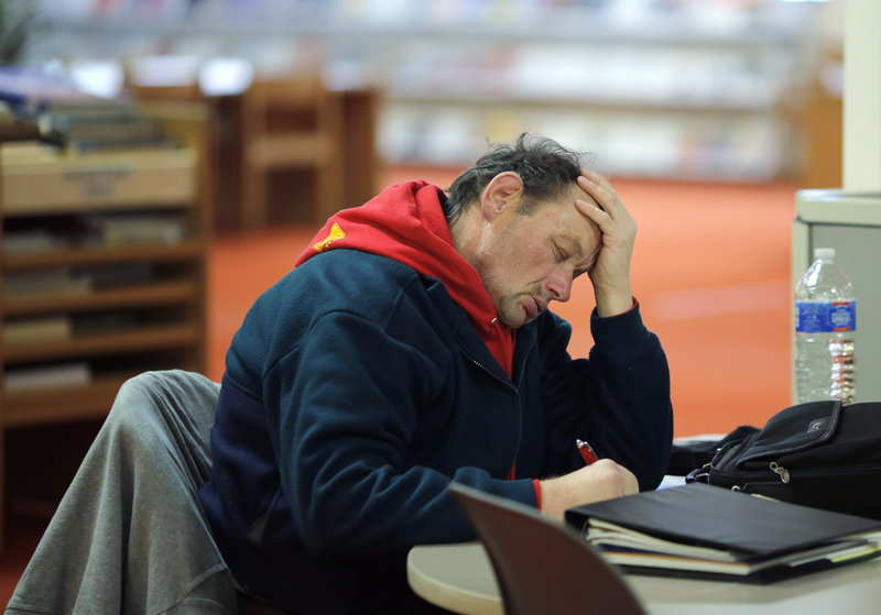 ... At the Portland Public Library, he fills out applications for housing. ...