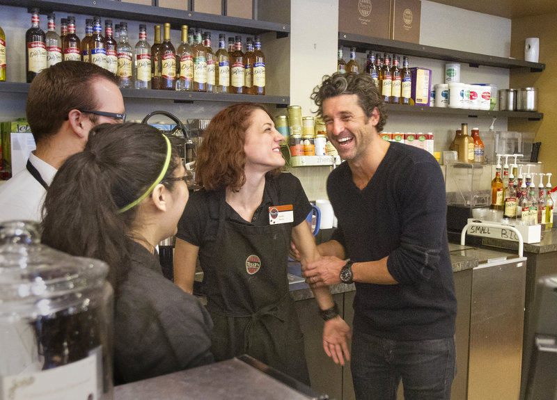 """Maine native and """"Grey's Anatomy"""" star Patrick Dempsey, right, meets the staff at the Tully's Coffee near the Pike Place Market in Seattle on Friday. His Global Baristas company won a bankruptcy auction to purchase the chain."""