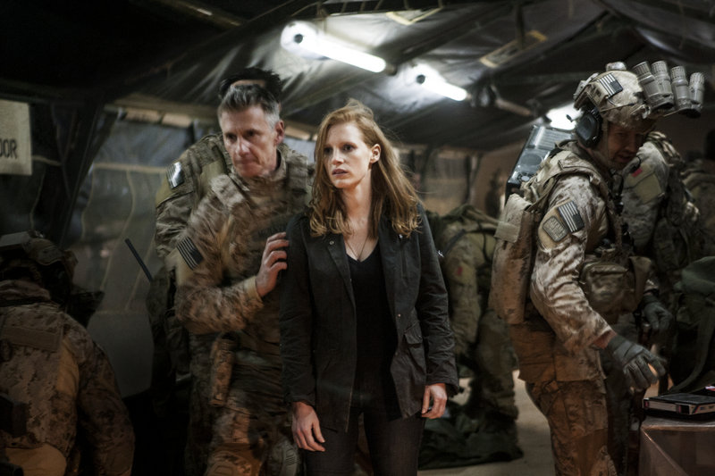 "Christopher Stanley, left, Jessica Chastain and Alex Corbet Burcher in ""Zero Dark Thirty."""