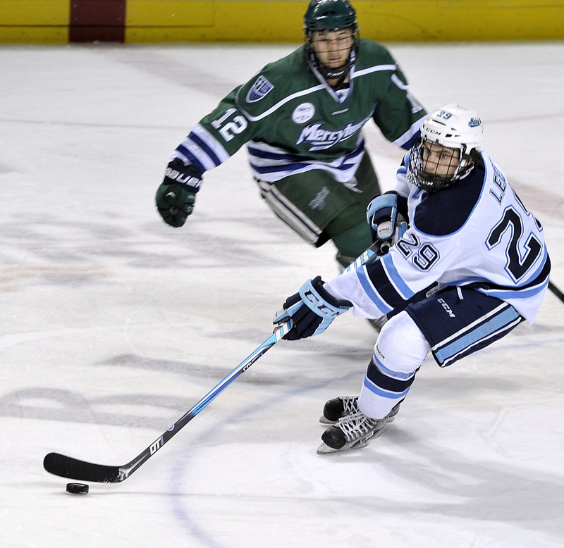 Maine's Connor Leen controls the puck as he's trailed by Mercyhurst's Zac Frischmon during Maine's 2-1 win at the Cumberland County Civic Center on Friday.