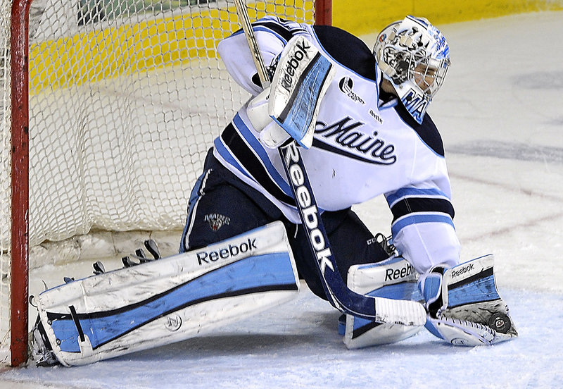 """Maine's Martin Ouellette had an outstanding night in the nets, as he finished with 25 saves, including some """"absolute game-savers."""""""