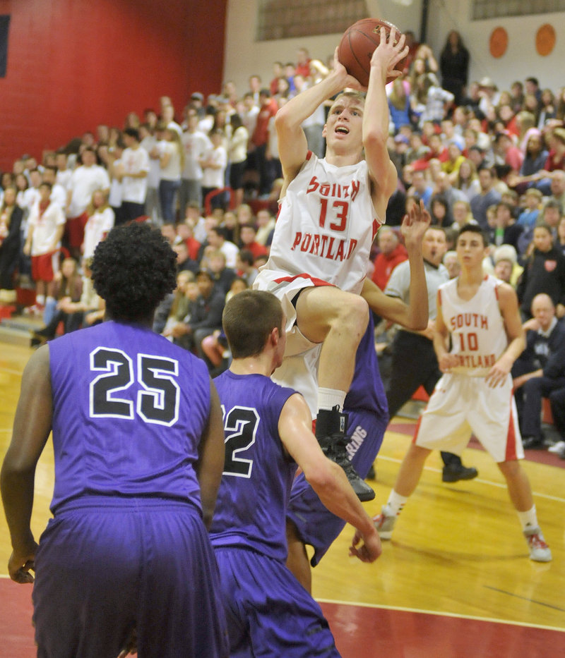 Tanner Hyland of South Portland finds room in the Deering defense to get off a shot Friday night. Hyland led the Red Riots with 15 points but the Rams came away with a 58-52 victory in overtime.