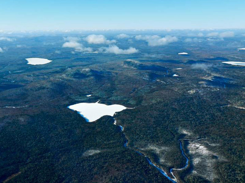 Bald Mountain, with Greenlaw Pond in the foreground, is owned by J.D. Irving of New Brunswick, which is considering mining the property for gold, silver and other deposits under rules the state is in the process of revising.