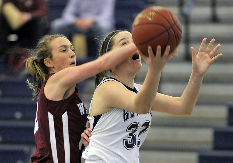 Sam Frost of Windham, left, knocks the ball from Brianna Holdren of Portland, who was attempting to score on a fast-break layup Saturday during their SMAA schoolgirl basketball game at the Portland Expo. Frost scored 12 points in Windham's 55-43 victory.