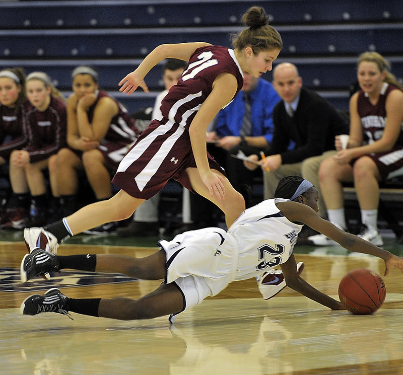 Elizabeth Donato of Portland dives for a loose ball ahead of Luisa Sbardella of Windham. Windham improved to 4-4 and Portland dropped to 2-7.