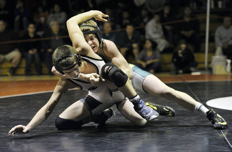 Tyler Everett of Massabesic controls his match against Ryan Peters of Timberlane High of Plaistow, N.H. Everett won the 126-pound division by defeating Peters, 6-4.