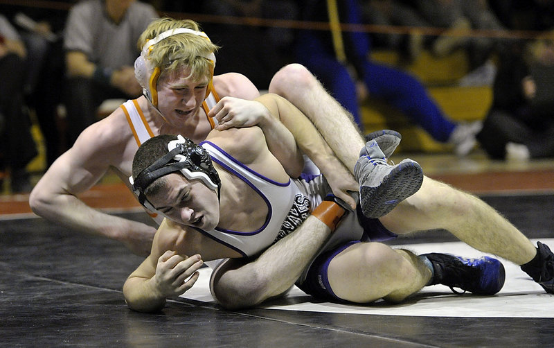 Jackson Howarth of Marshwood attempts to work out of a hold applied by Shane Jennings of Danbury, Conn., during the wrestling tournament in Sanford. Howarth reached the 145-pound final.