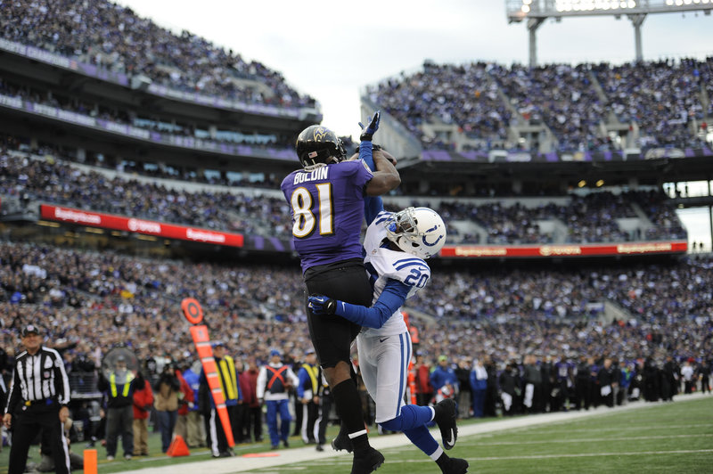 Baltimore wide receiver Anquan Boldin (81) hauls in a touchdown pass against Indianapolis cornerback Darius Butler (20) in the fourth quarter of the Ravens' 24-9 wild-card win. Boldin set a team record with 145 yards receiving.