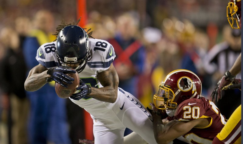 Sidney Rice of the Seahawks makes a catch against Washington's Cedric Griffin. Seattle snapped an eight-game road losing streak in the playoffs and advanced to face Atlanta in an NFC divisional playoff game Sunday.
