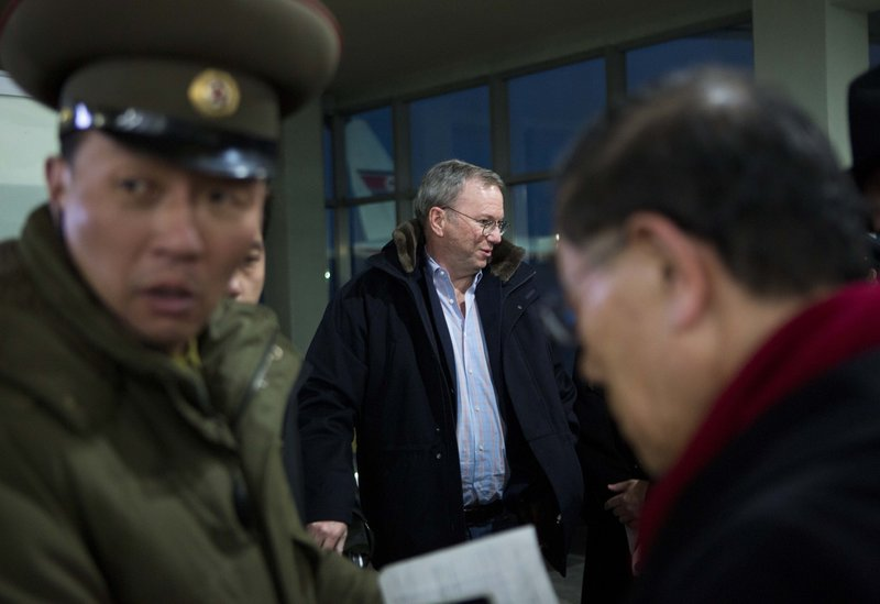Eric Schmidt, executive chairman of Google, center, arrives at the airport in Pyongyang, North Korea, on Monday. He is the highest profile U.S. executive to visit the country.