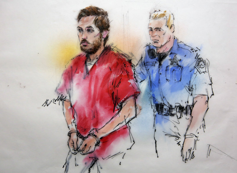 This courtroom sketch shows accused killer James Holmes being escorted by a deputy as he arrives at a preliminary hearing at which he showed no emotion Monday.