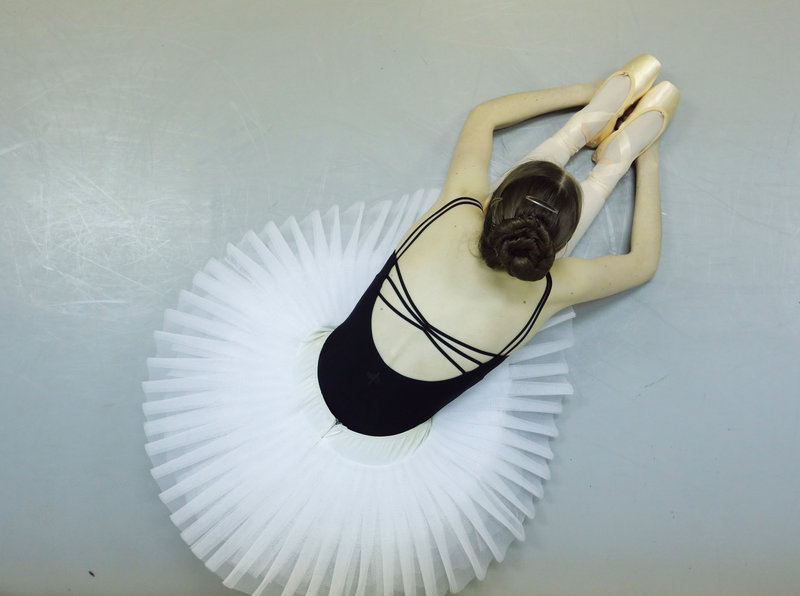 "Emily Avery, 17, stretches during a break in dance practice at Portland Ballet. Avery commutes to the class from Stratham, N.H., for the ""really excellent training."""