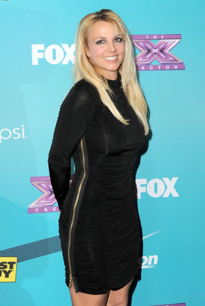 """Britney Spears is out as a judge on the """"X-Factor."""" The pop singer failed to help boost ratings on the show."""