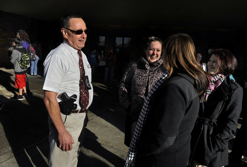Retired Pennsylvania state trooper Les Strawbridge chats with Butler Intermediate High School teachers. The school system hired enough retired troopers to put one in each school.