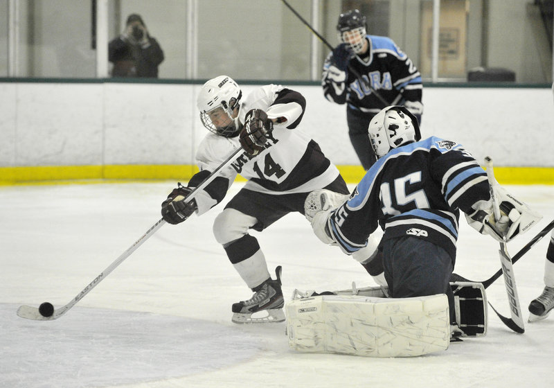 Pete Hurley of Greely pushes a rebound past York goalie Eric Lindbom for a goal that made it 8-0 in the second period Thursday night. Greely went on to a surprisingly one-sided 13-0 victory.