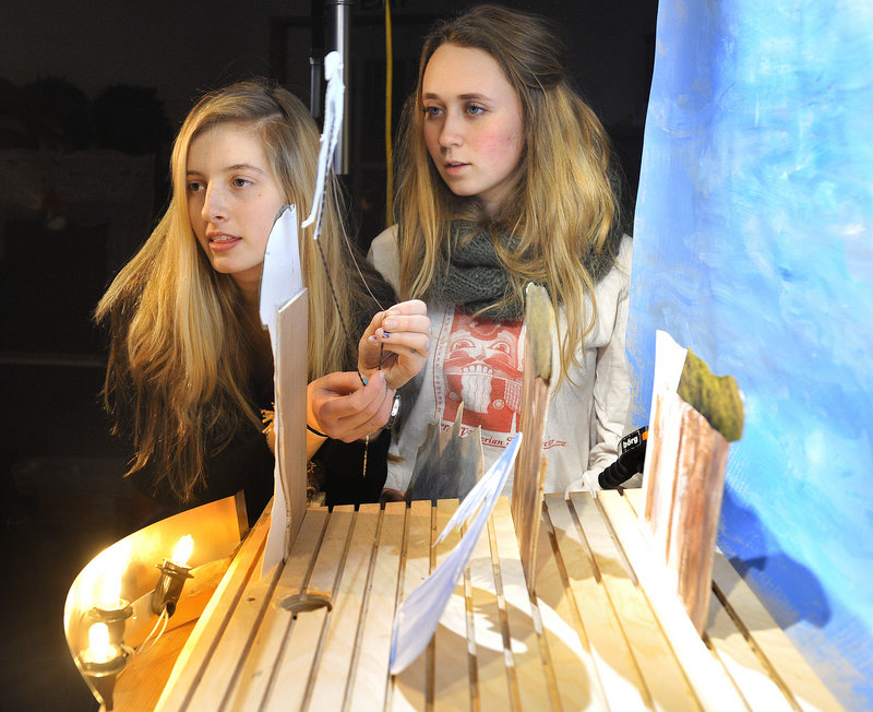"""Students Sarah Grace, left, and Charlotte Spritz work on producing a film version of """"Frankenstein"""" using small paper puppets at Figures of Speech Theatre in Freeport."""