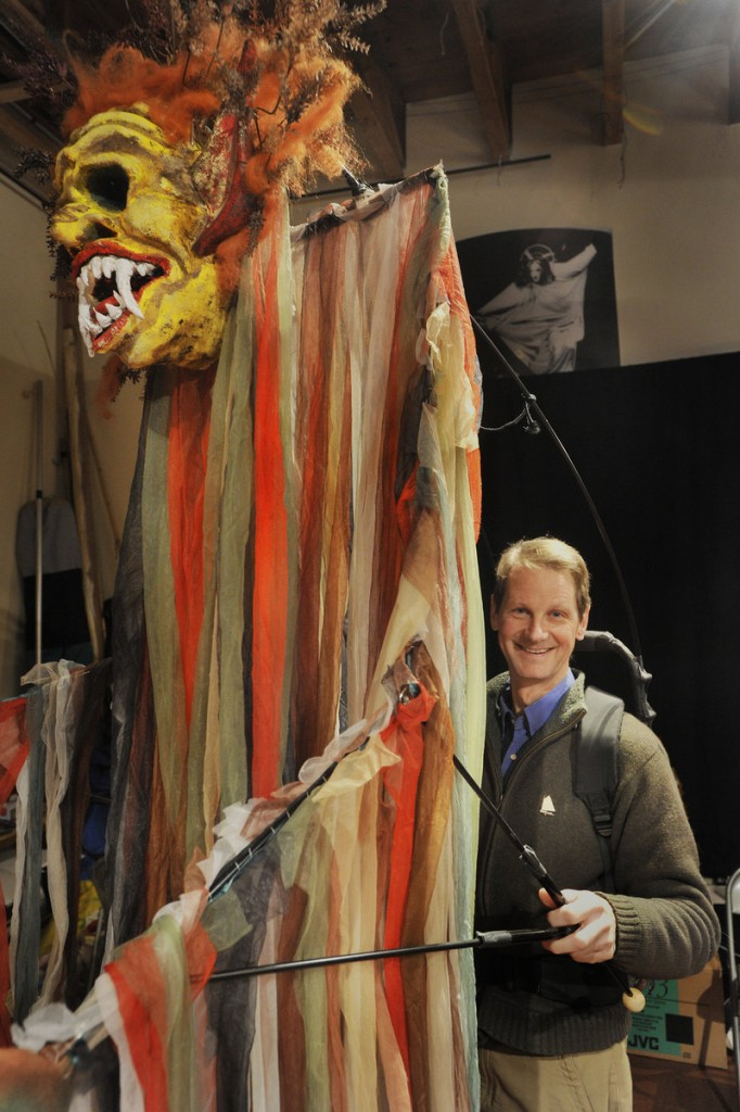 """John Farrell of Figures of Speech Theatre in Freeport with a giant puppet he created to portray the witch Sycorax in """"The Tempest."""" Farrell and his wife, Carol, were among the first puppet theater artists based in Maine and have taken their performances around the world."""