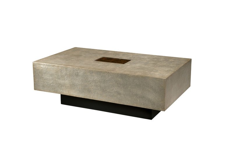 An Art of Concealment coffee table from furniture maker Theodore Alexander.