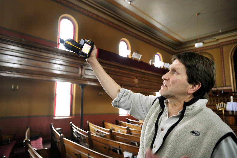 Friday, January 11, 2013: Energy consultant DeWitt Kimball uses a thermal energy sensor to look for heat leaks in the church building.