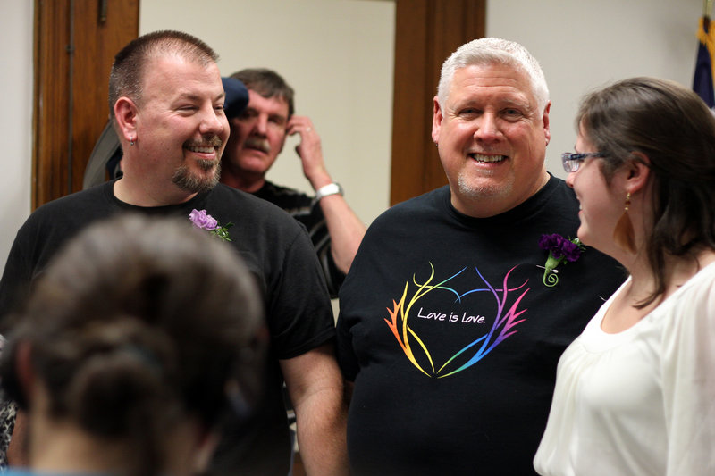Steven Bridges, left, and Michael Snell at Portland's City Hall on Dec. 28, the night they wed.