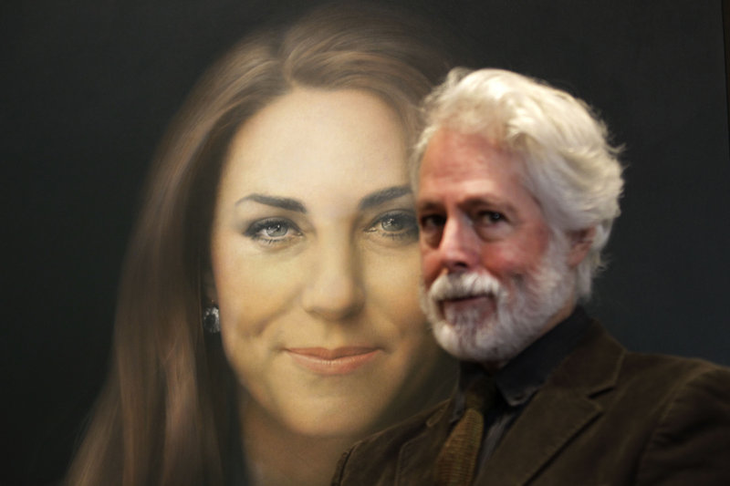 Paul Emsley poses next to his newly commissioned portrait of Kate, Duchess of Cambridge, on display Friday at the National Portrait Gallery in London.
