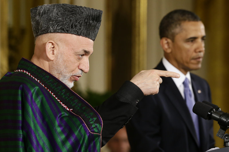 Afghan President Hamid Karzai takes questions from reporters during his joint news conference with President Barack Obama at the White House.