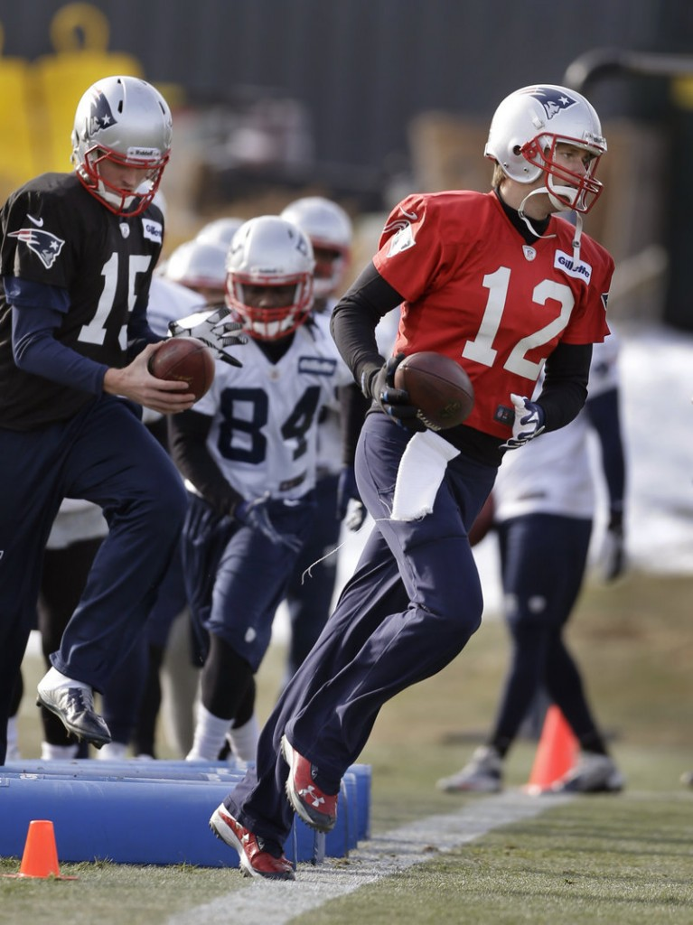Tom Brady runs through drills at a practice in Foxborough last week. The veteran quarterback is 16-6 in the postseason – a mark that will change for better or for worse against Houston.
