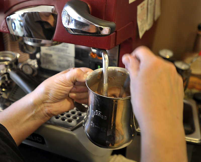 Marguerite Swoboda uses the frother on her espresso machine to make her salted caramel hot chocolate.