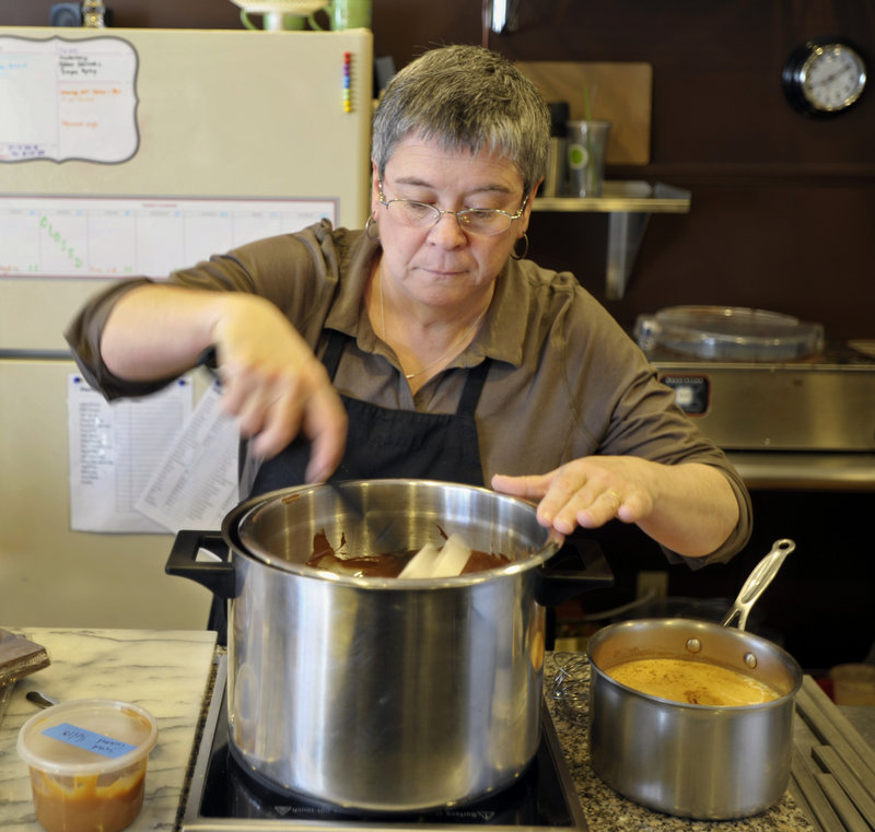 Marguerite Swoboda of Sweet Marguerites in South Portland melts chocolate that she'll use in her salted caramel hot chocolate.