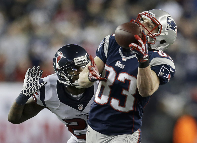 Wes Welker hauls in a pass behind Texans cornerback Kareem Jackson for a 47-yard gain in the first half Sunday at Gillette Stadium. The catch set up an 8-yard touchdown pass to Shane Vereen, and the Patriots went on to a 41-28 victory.