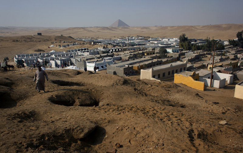 The illegal expansion of a local cemetery is seen spreading toward Egypt's first pyramids and temples at the ancient historic site of Dahshour, causing a panic among antiquities experts, who warn that construction endangers the ancient, largely unexplored complex.