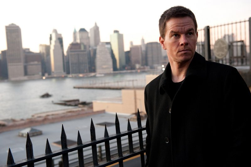 Mark Wahlberg, above, stars as private investigator Billy Taggart, who is hired by New York's mayor, played by Russell Crowe, below, to follow his wife, played by Catherine Zeta-Jones.